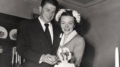 PHOTO: Newlyweds Ronald Reagan and Nancy Reagan cut their wedding cake at the Holden's house in Toluca Lake, California on March 4. 1952.