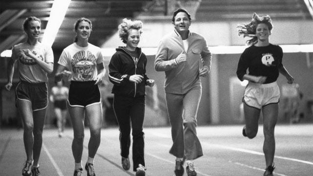 PHOTO: Senator Birch Bayh exercises with Title IX athletes at Purdue University, circa 1970s.