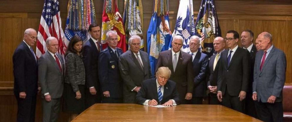 PHOTO: President Donald Trump, flanked by his cabinet members, signs on August 18, 2017 at Camp David the Global War on Terrorism War Memorial Act.