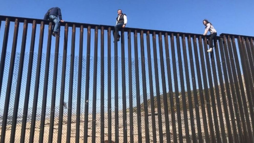 Mexican congressman Braulio Guerra sits atop the U.S.-Mexico border wall that divides Tijuana, Mexico, from California on March 1, 2017.