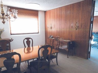 PHOTO: A photo in documents provided by HUD to ABC News shows the table and chairs in a dining room adjacent to Sec. Ben Carsons office.