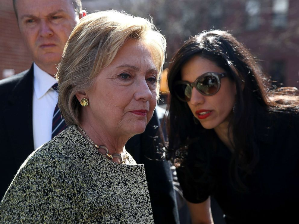 PHOTO: Democratic presidential candidate former Secretary of State Hillary Clinton (L) talks with aide Huma Abedin (R) before speaking at a neighborhood block party on April 17, 2016 in New York City.