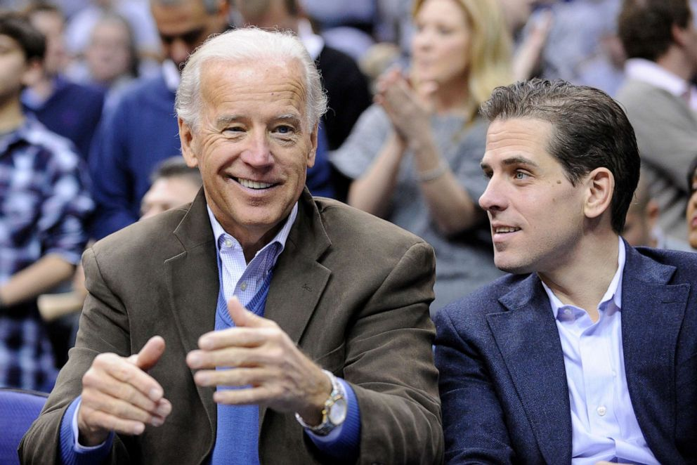 PHOTO: Vice President Joe Biden, left, with his son Hunter, right, at the Duke Georgetown NCAA college basketball game in Washington D.C., Jan. 30, 2010.