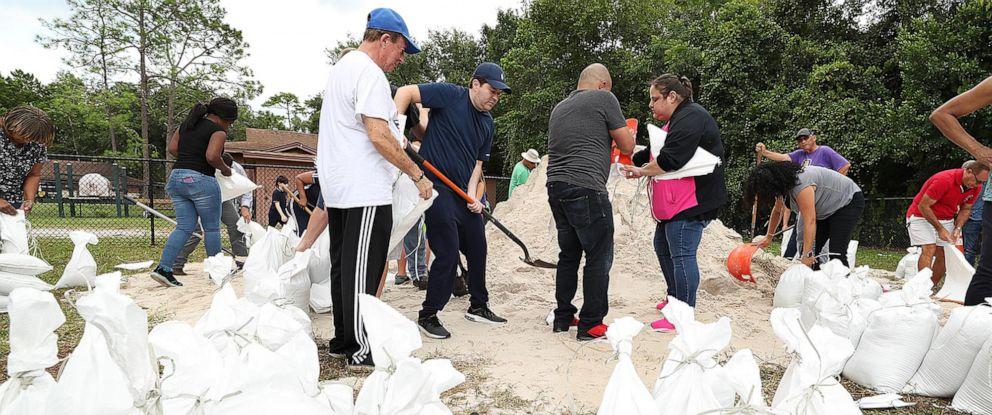 PHOTO: Dozens of Orange County residents fill sandbags in advance of Hurricane Dorian at Blanchard Park in Orlando, Fla. on Aug. 28, 2019.
