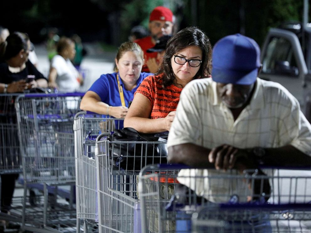 PHOTO: Shoppers wait in line for a Sams Club store to open before sunrise, as people rushed to buy supplies ahead of the arrival of Hurricane Dorian in Kissimmee, Fla., Aug. 30, 2019.