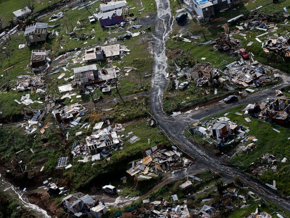 PHOTO: The rubble of homes is scattered in the aftermath of Hurricane Maria in Toa Alta, Puerto Rico, one week after the storm hit, Sept. 28, 2017.