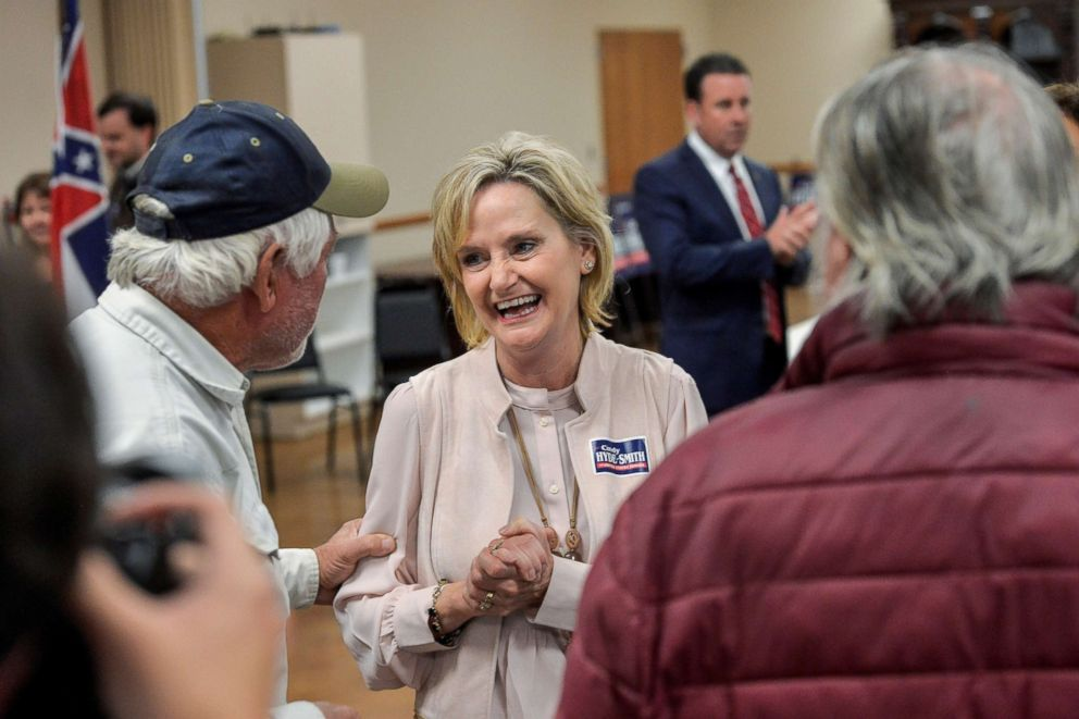PHOTO: Senator Cindy Hyde-Smith speaks with supporters during a campaign stop at the Northwest Mississippi Association of Realtors office in Nesbit, Miss., Oct. 26, 2018.