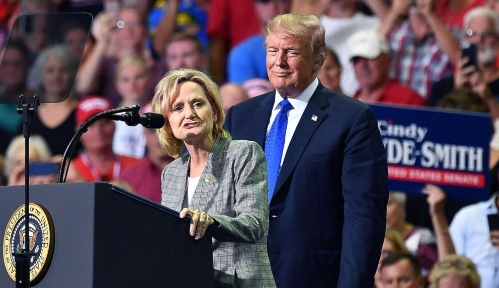 PHOTO: Senator Cindy Hyde-Smith takes the stage with President Donald Trump at a Make America Great Again rally at Landers Center in Southaven, Miss., on Oct. 2018.