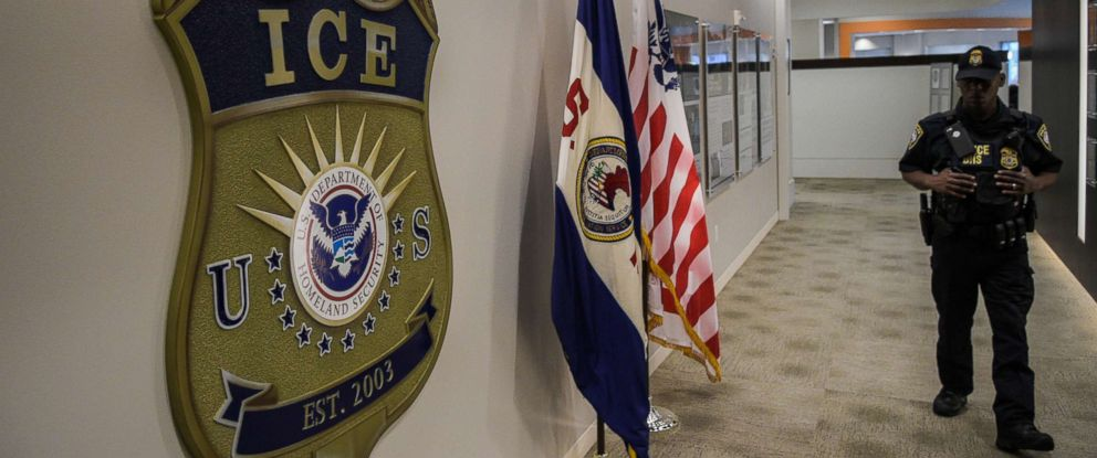 PHOTO: A law enforcement officer walks past ICE logo ahead of a press conference, May 11, 2017, at the U.S. Immigration and Customs Enforcement headquarters in Washington, D.C.