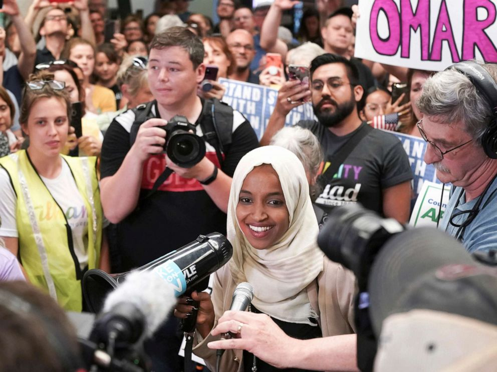 PHOTO: Rep. Ilhan Omar speaks to supporters as she arrives at Minneapolis Saint Paul International Airport, July 18, 2019, in Minnesota.