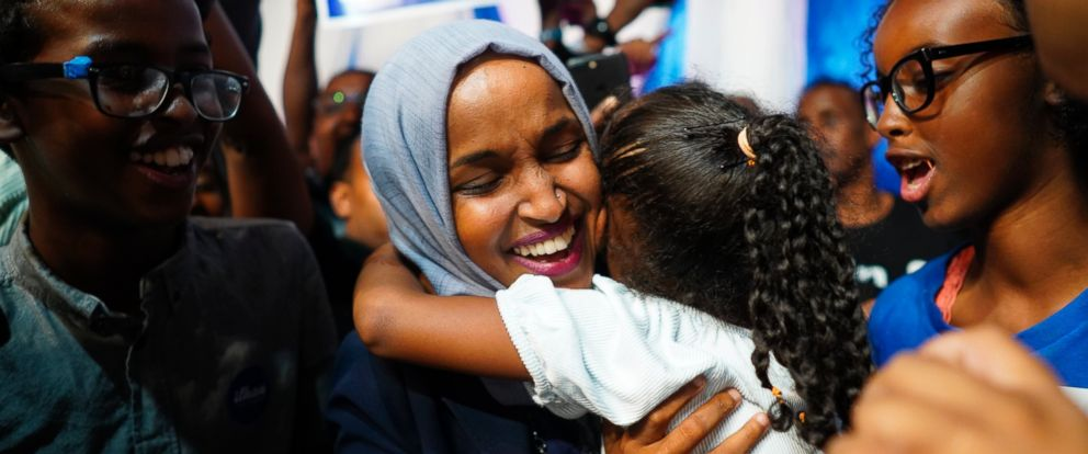 Minnesota Rep. Ilhan Omar celebrates with her children after her Congressional 5th District primary victory, Tuesday, Aug. 14, 2018, in Minneapolis.
