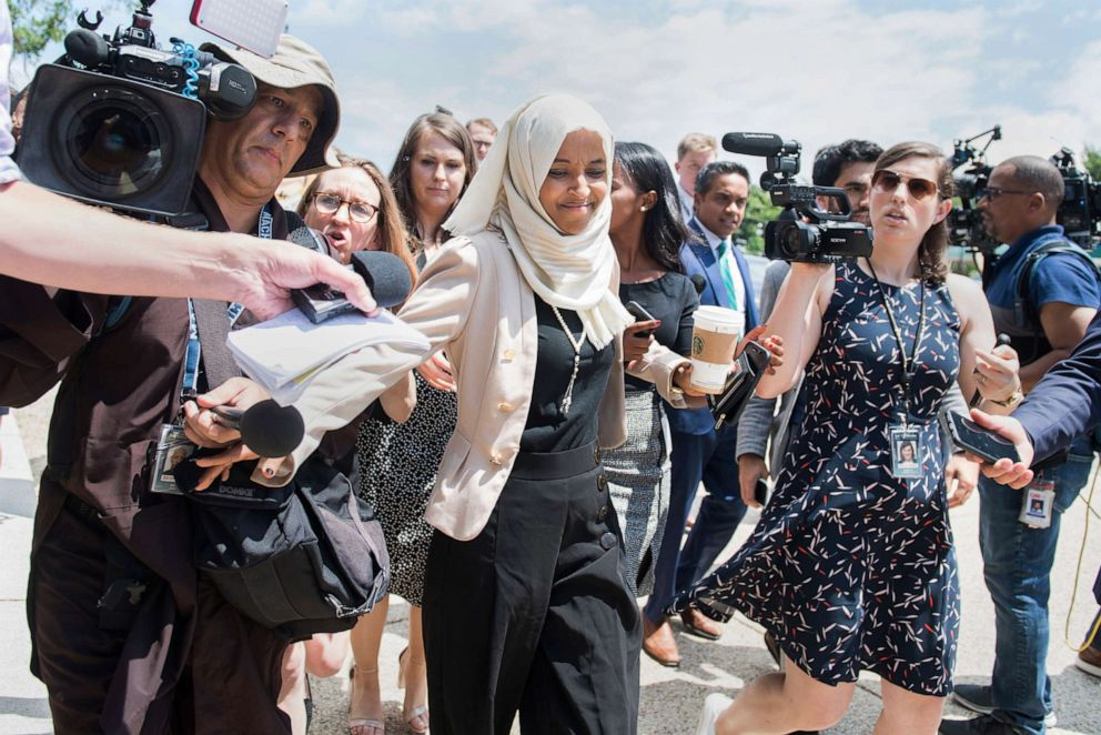 PHOTO: Rep. Ilhan Omar responds to reporters questions after a vote in the Capitol, about derogatory comments made by President Trump about her and other freshmen members, July 18, 2019.