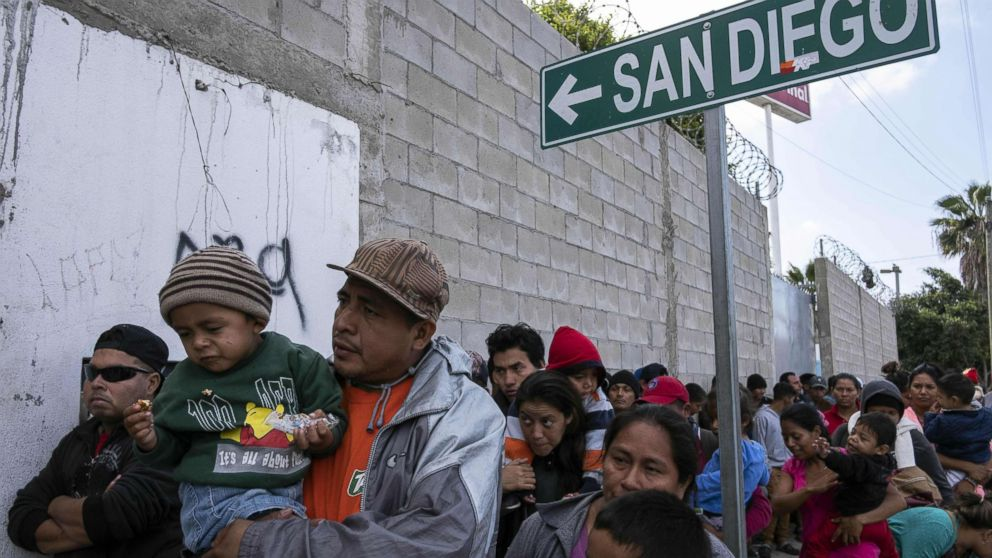 Central American migrants queue outisde the Padre Chava's kitchen soup for breakfast and legal counseling, in Tijuana, Mexico, April 27, 2018. The US has threatened to arrest around 100 Central American migrants if they try to sneak in from the US-Mexico border where they have gathered, prompting President Donald Trump to order troop reinforcements on the frontier.