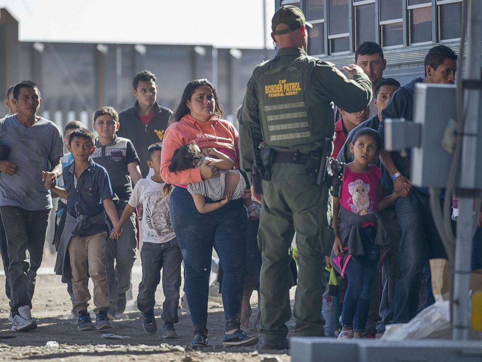 PHOTO: Migrants are loaded onto a bus by U.S. Border Patrol agents after being detained when they crossed into the United States from Mexico on June 01, 2019 in El Paso, Texas.