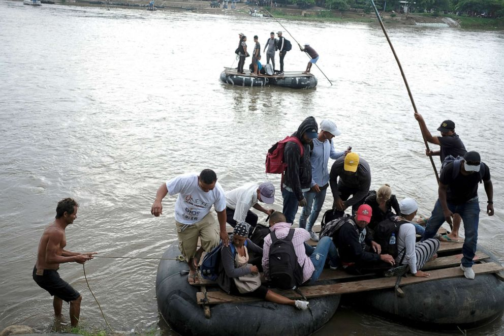 PHOTO: Central American migrants get off a raft after crossing the Suchiate river from Tecun Uman, in Guatemala, to Ciudad Hidalgo, as seen from Ciudad Hidalgo, Mexico, June 11, 2019.