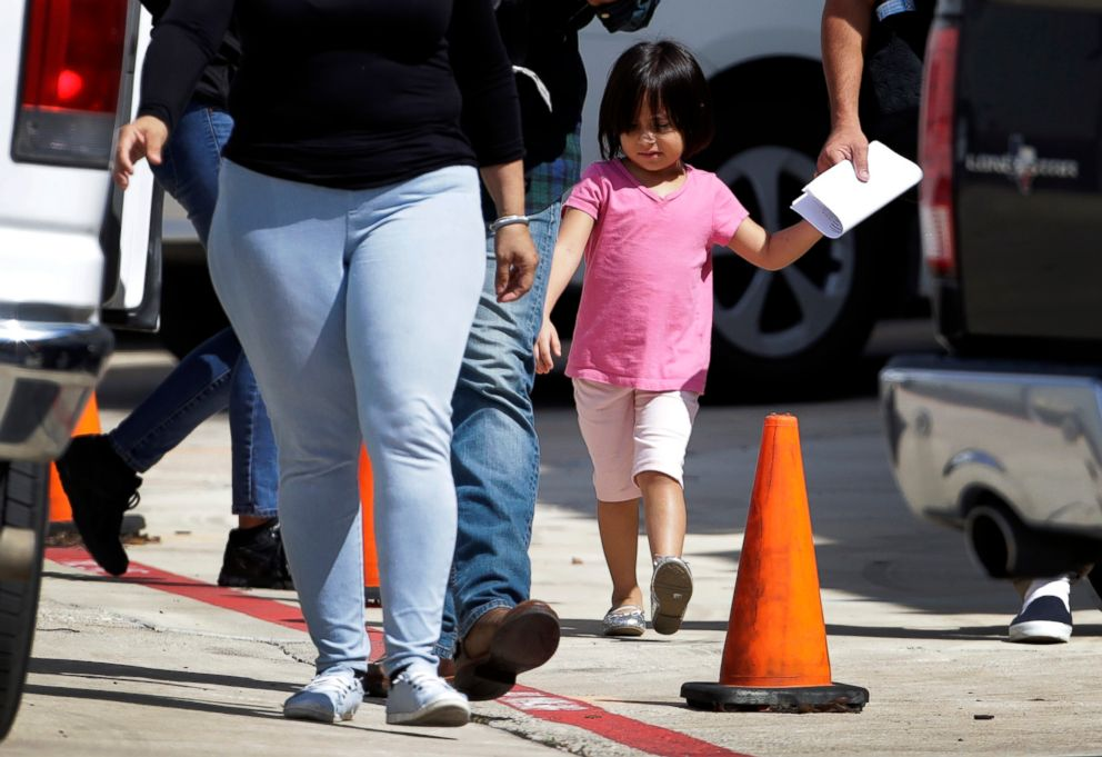 PHOTO: Immigrant families leave a United States Immigration and Customs Enforcement facility after they were reunited, July 11, 2018, in San Antonio.