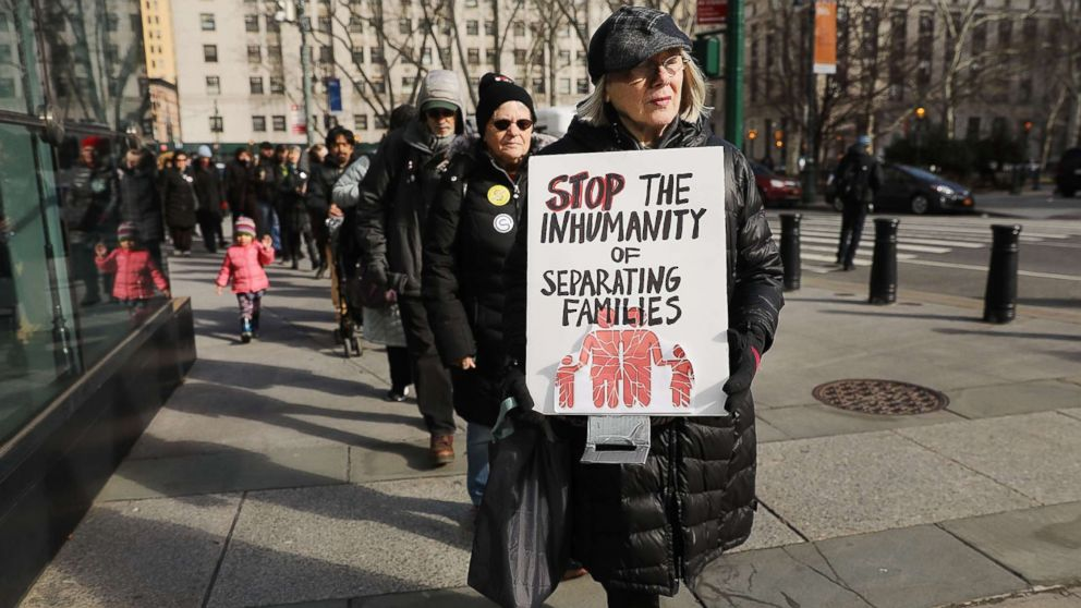A woman carries a sign in a demonstration where immigration activists, clergy members and others gathered against the imprisonment and potential deportation of an immigration activist in front of the Federal Building on Jan. 29, 2018 in New York.
