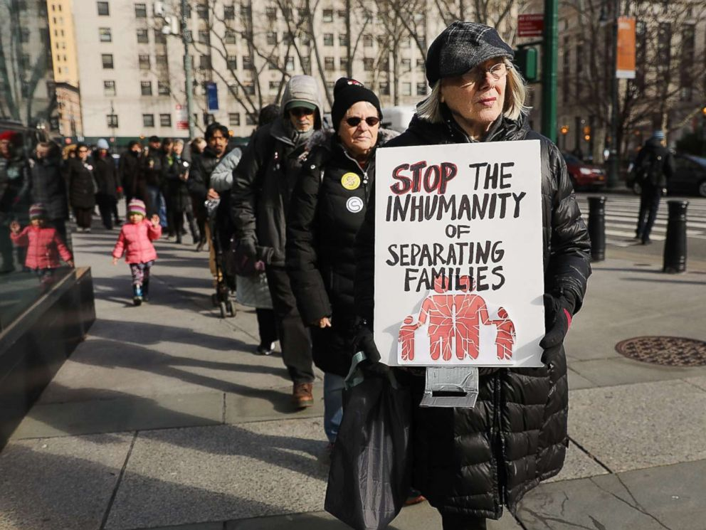 PHOTO: A woman carries a sign in a demonstration where immigration activists, clergy members and others gathered against the imprisonment and potential deportation of an immigration activist in front of the Federal Building on Jan. 29, 2018 in New York.