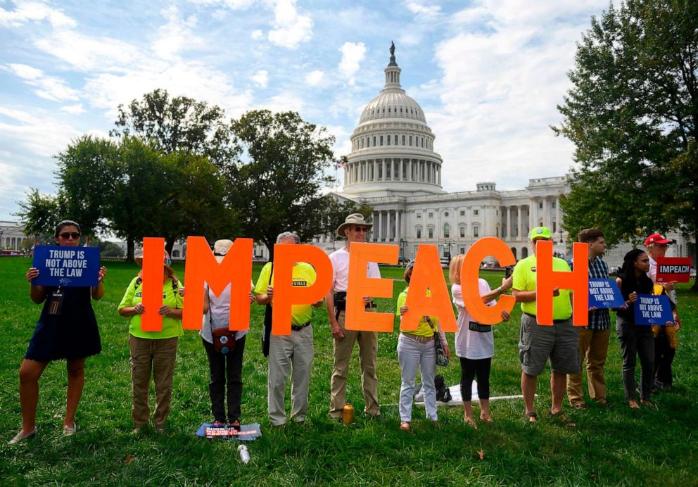 PHOTO: Demonstrators hold up letters reading impeach in front of the Capitol building during the Peoples Rally for Impeachment, Sept. 26, 2019.