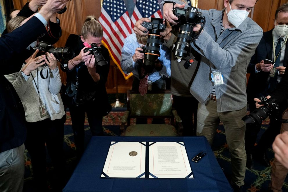 PHOTO: Photographers take pictures of the article of impeachment against President Donald Trump prior to it being signed at the U.S. Capitol on Jan. 13, 2021, in Washington, D.C.