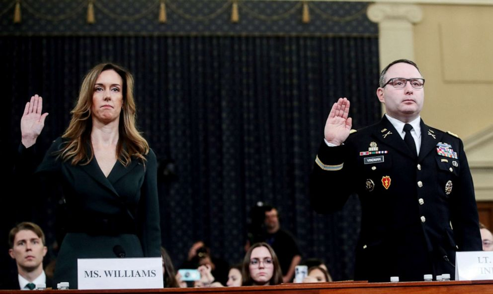 PHOTO: Jennifer Williams and Alexander Vindman are sworn in to testify before a House Intelligence Committee hearing on Capitol Hill in Washington D.C., Nov. 19, 2019.