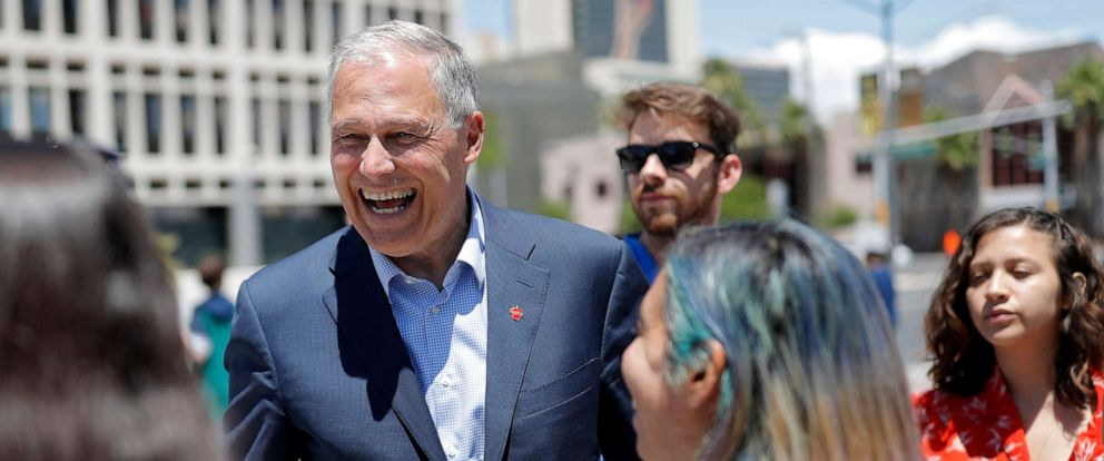 PHOTO: Democratic Presidential candidate Washington Gov. Jay Inslee, center, meets with students at a climate change rally, May 24, 2019, in Las Vegas.