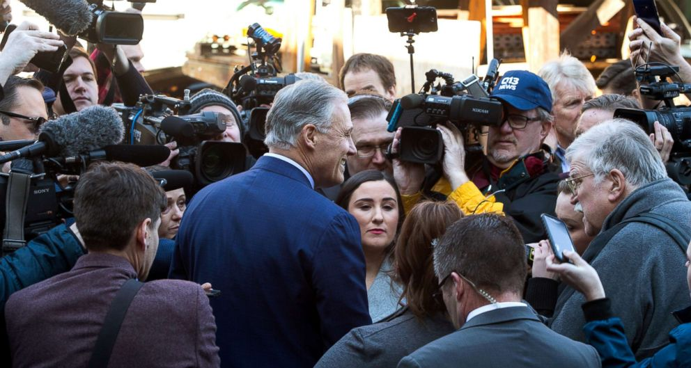 PHOTO: Washington Gov. Jay Inslee is surrounded by the press after he announces his run for the 2020 Presidency, March 1, 2019 in Seattle.