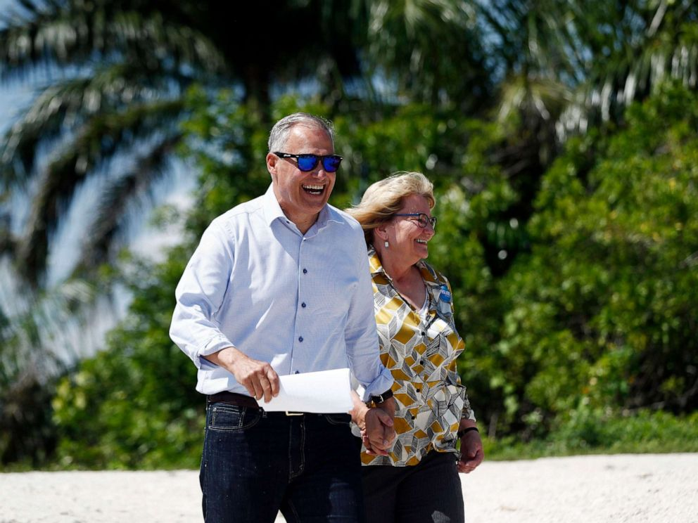 PHOTO: Democratic presidential candidate Washington Gov. Jay Inslee, and his wife, Trudi, walk up to speak at a news conference at the Everglades Holiday Park, June 24, 2019, in Fort Lauderdale, Fla.