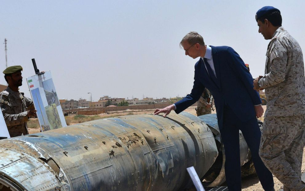 PHOTO: Brian Hook (2nd R), the US special representative on Iran, checks what Saudi officials said were Iranian remnants of a cruise missile that slammed into Abha airport on June 12, during a visit to an army base in al-Kharj, on June 21, 2019.
