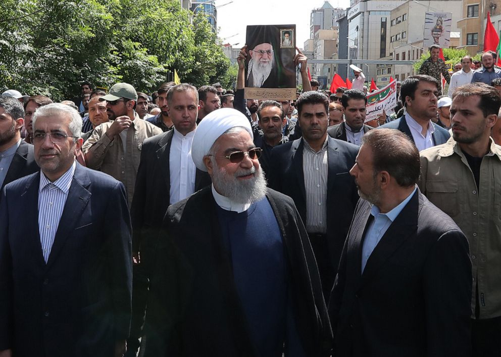 PHOTO: A handout picture provided by the presidential office shows Iranian President Hassan Rouhani (C) attending a parade marking al-Quds (Jerusalem) International Day in Tehran on May 31, 2019.