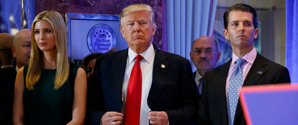 PHOTO: In this Jan. 11, 2017, photo, President-elect Donald Trump, center, stands next to Allen Weisselberg, second from left, Donald Trump Jr., right and Ivanka Trump, left, at a news conference in the lobby of Trump Tower in New York.