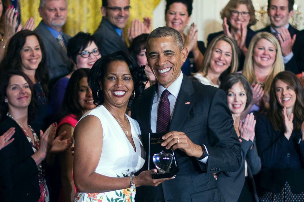Jahana Hayes, left, a high school history teacher from Waterbury, CT, celebrates winning the 2016 National Teacher of the Year with President Barack Obama at the White House in Washington, May 3, 2016.