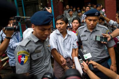 PHOTO: Police escort detained Myanmar journalist Kyaw Soe Oo after appearing before a court trial in Yangon, Myanmar, Aug. 20, 2018.