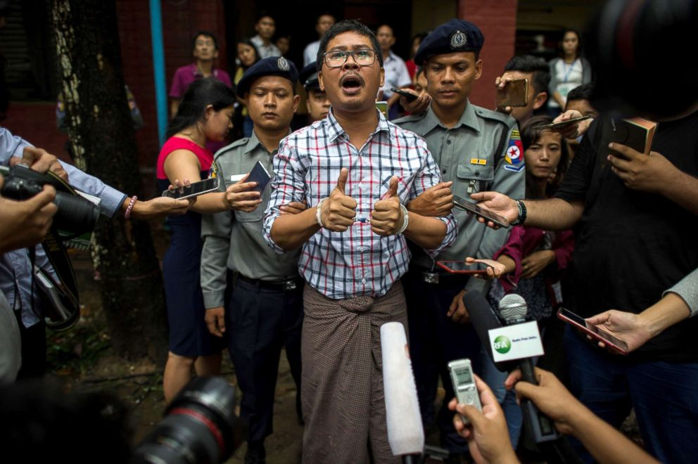 Detained Myanmar journalists Wa Lone speaks to journalist after appearing before a court trial in Yangon, Myanmar, Aug. 20, 2018.