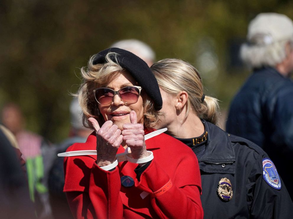 PHOTO: Actor and activist Jane Fonda gives a thumbs up in handcuffs as she is detained for blocking the street in front of the Library of Congress during the Fire Drill Fridays protest in Washington, Oct. 18, 2019.