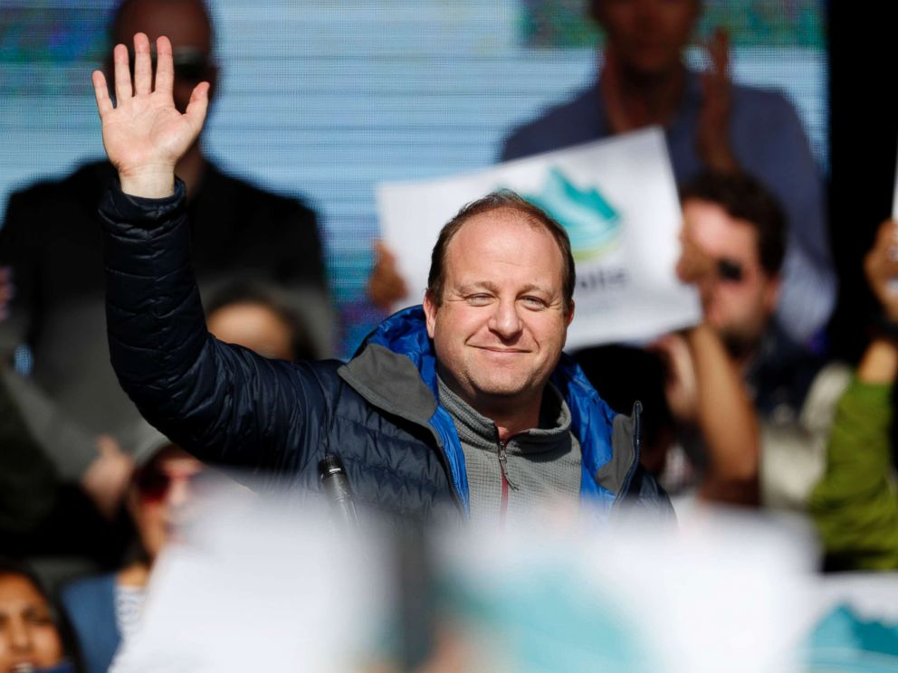 PHOTO: Jared Polis, Colorados Democratic candidate for governor, waves to the crowd during a rally with young voters on the campus of the University of Colorado, Oct. 24, 2018, in Boulder, Colo.