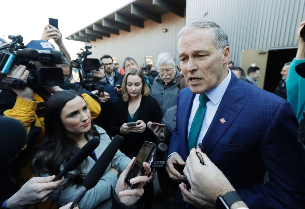 Washington Governor Jay Inslee answers questions from reporters after speaking at a campaign event in Seattle, March 1, 2019.