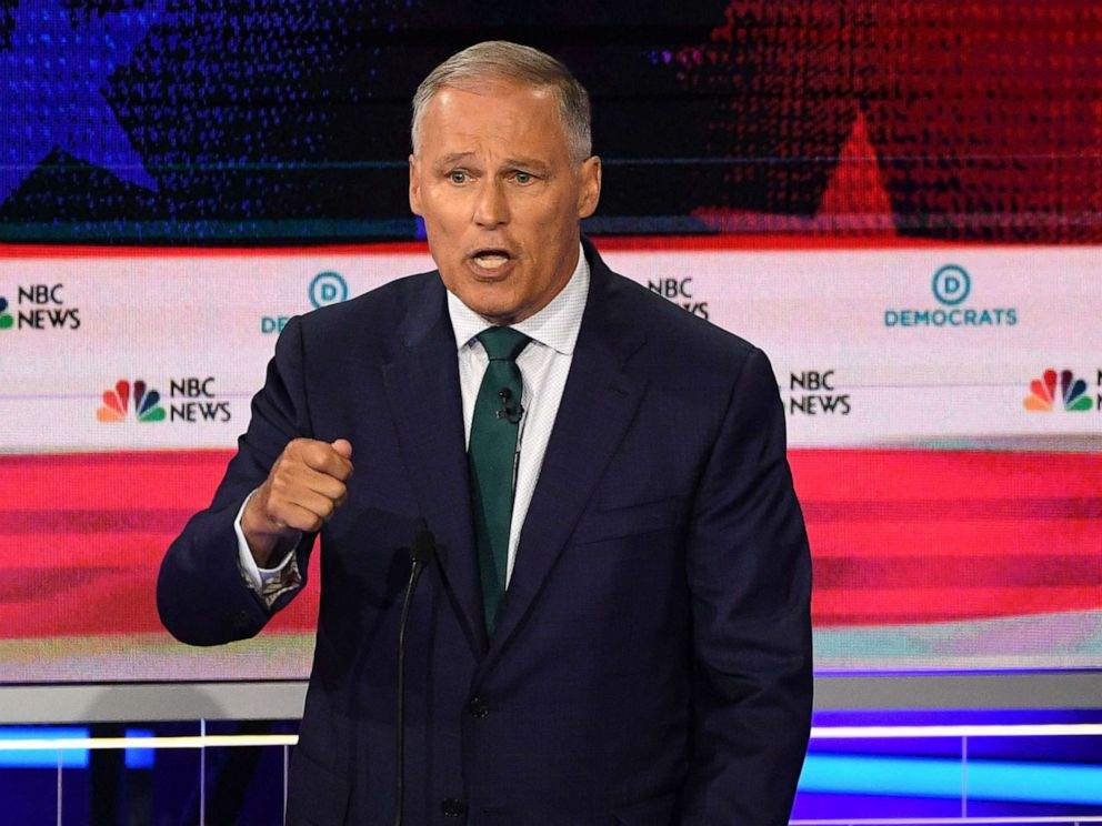 PHOTO: Jay Inslee participates in the first Democratic primary debate hosted by NBC News at the Adrienne Arsht Center for the Performing Arts in Miami, Florida, June 26, 2019.