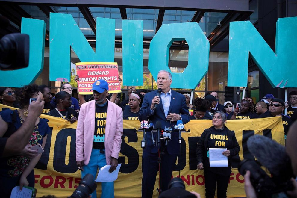 PHOTO: Democratic presidential candidate and Washington governor Jay Inslee joins demonstrators at a rally in front of McDonalds corporate headquarters to demand $15-per-hour wages for fast food workers, May 23, 2019, in Chicago.