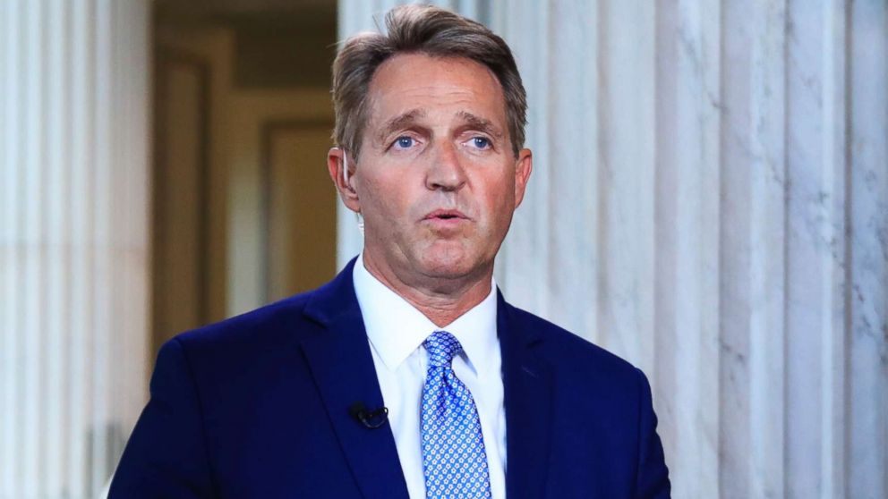 Sen. Jeff Flake speaks during a television interview on Capitol Hill in Washington, D.C., Oct. 24, 2017.
