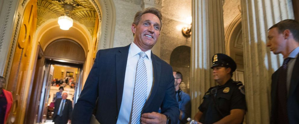 PHOTO: Republican Senator from Arizona Jeff Flake walks off the Senate floor after the Senate voted down a bill to repeal the Affordable Care Act without a replacement, on Capitol Hill in Washington, July 26, 2017.