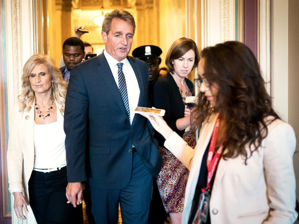 PHOTO: Sen. Jeff Flake walks with his wife, Cheryl, on Capitol Hill in Washington, Oct. 3, 2018.