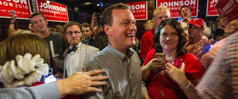 Minnesota gubernatorial candidate Jeff Johnson, center, is greeted by his supporters after returning to the watch party, Tuesday, Aug. 14, 2018, in Plymouth, Minn.