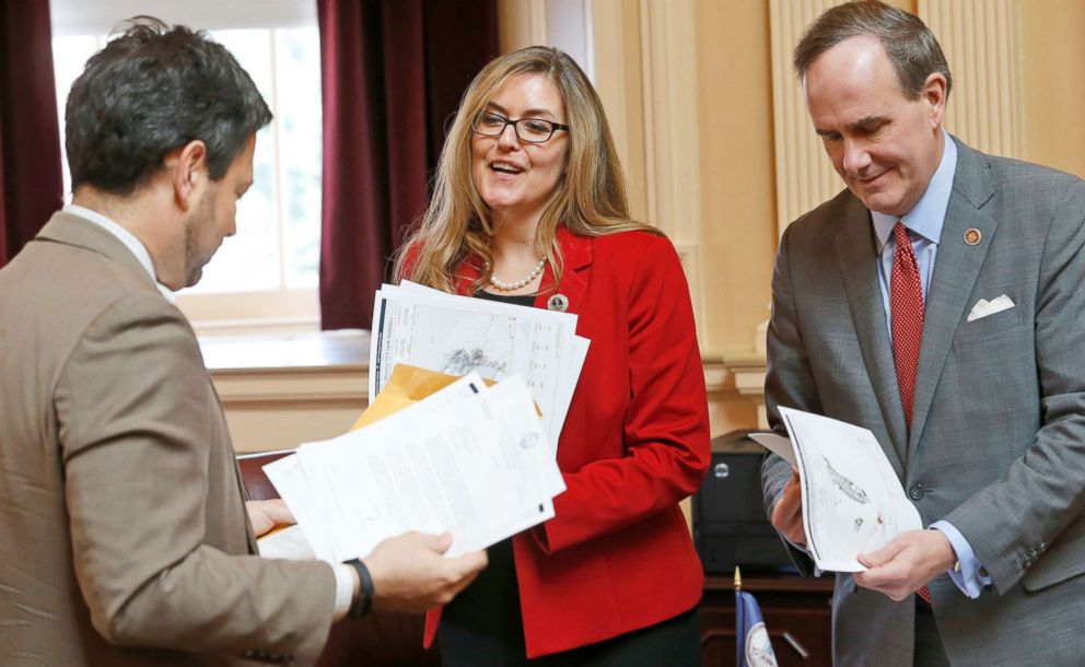 PHOTO: Virginia State Sen. Jennifer Wexton, center, talks with Sen. Scott Surovell, left, and Sen, Lynwood Lewis. Jr., during the Senate special budget session at the Capitol in Richmond, Va.
