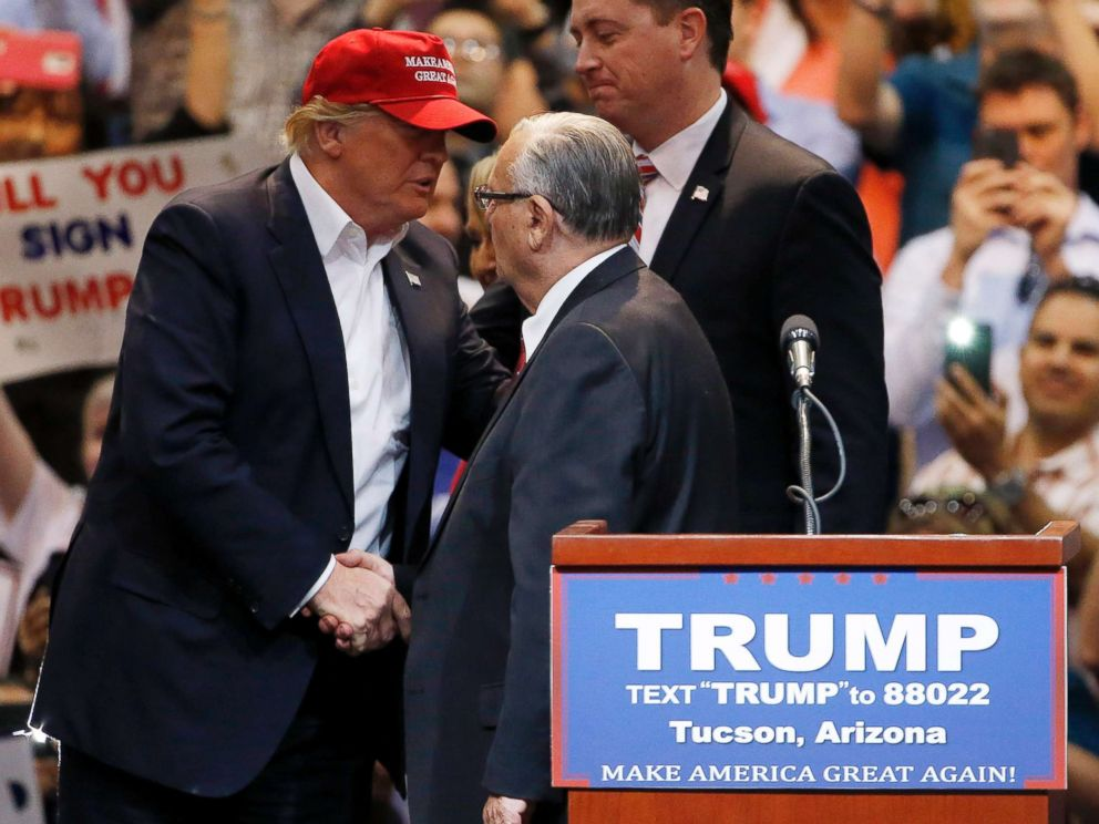 PHOTO: Then presidential candidate Donald Trump shakes hands with Maricopa County Sheriff Joe Arpaio prior to speaking at a campaign rally, March 19, 2016, in Tucson, Ariz.