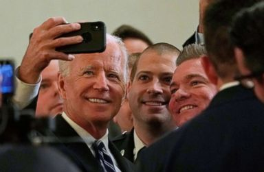 PHOTO: Former Vice President Joe Biden poses for a selfie after addressing the International Association of Fire Fighters in Washington, March 12, 2019.