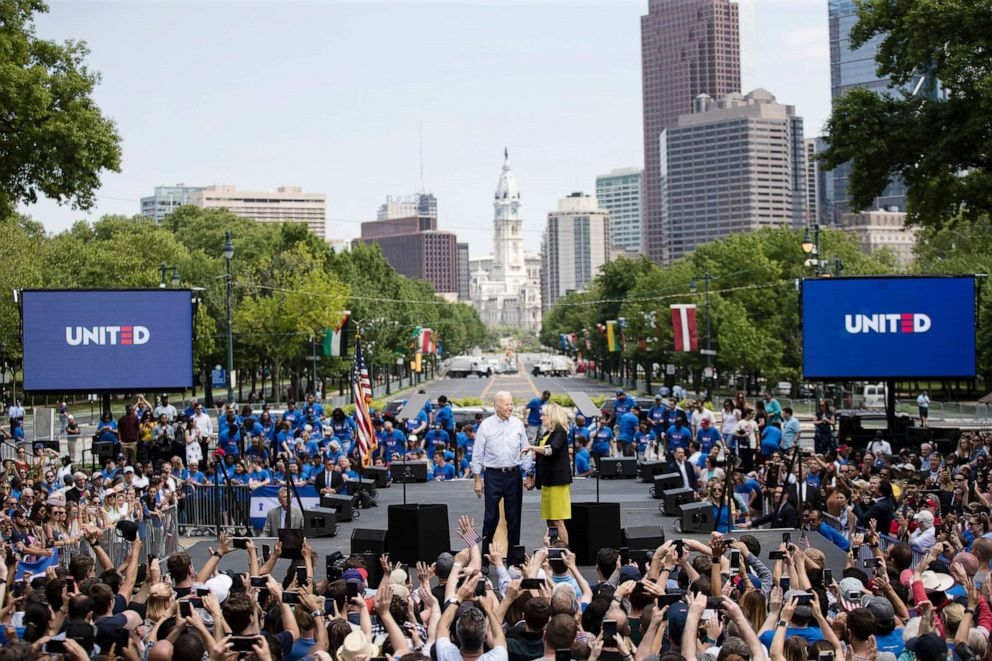 PHOTO: Democratic presidential candidate, former Vice President Joe Biden stands with his wife Jill at the end of a campaign rally in Philadelphia.