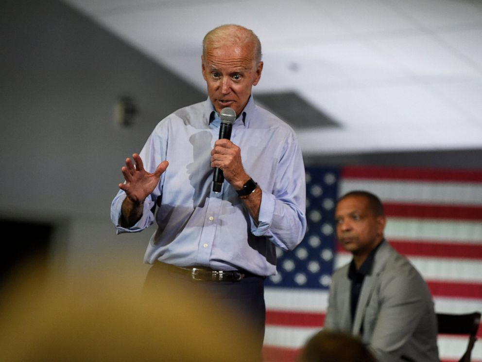 PHOTO: Democratic presidential candidate and former Vice President Joe Biden speaks at a town hall on Sunday, July 7, 2019, in Charleston, S.C., as state Sen. Marlon Kimpson looks on.