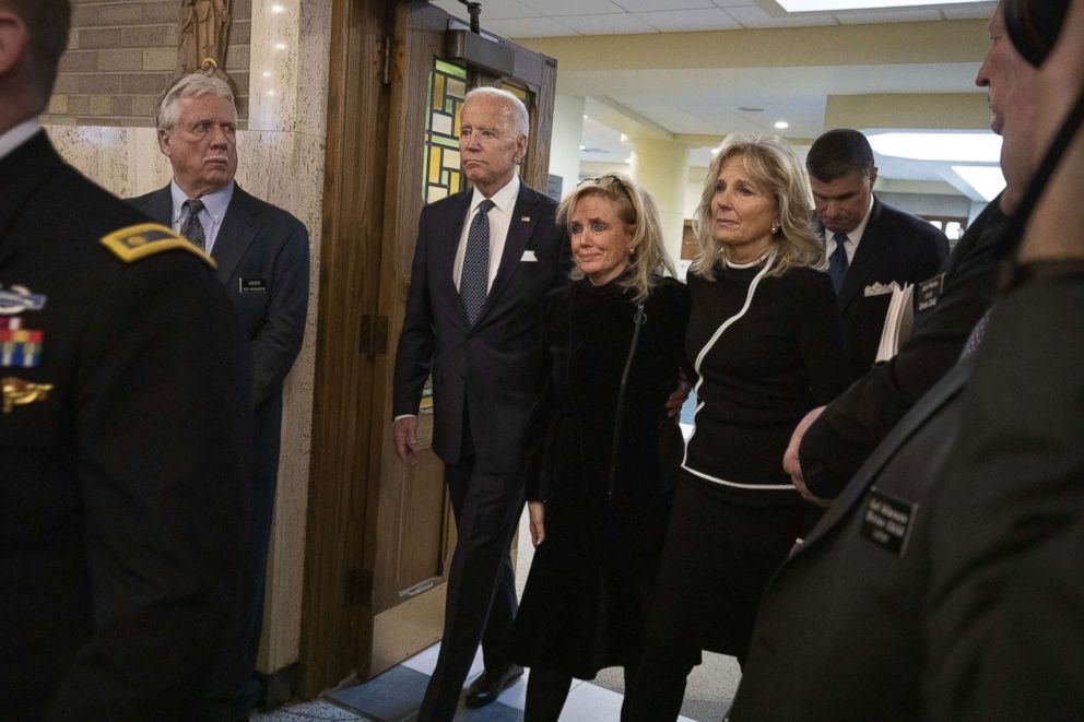 PHOTO: Congresswoman Debbie Dingell arrives with former Vice President Joe Biden and his wife Jill Biden, for the funeral of her husband former congressman John Dingell at the Church of the Divine Child on Feb. 12, 2019, in Dearborn, Mich.