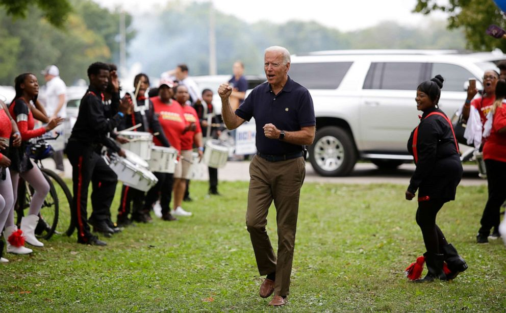 PHOTO: Former Vice President and presidential candidate Joe Biden clinches his fist as he arrives during the Democratic Polk County Steak Fry on Sept. 21, 2019, in Des Moines, Iowa.